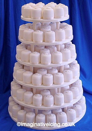 Ivory Mini Cakes Wedding Cake Tiered On Pillars