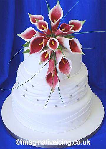 White Wedding Cake With Burgundy Sugar Flower Lilys