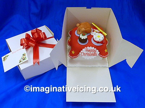 Now in stock! at Imaginative Icing York and Scarborough UK Shops - Ready Made Fully iced & decorated Christmas Cake Christmas Table with handmade sugar models of a roasted Turkey, Christmas Cake, Christmas Cracker, Christmas Pudding and Napkin - gift boxed with gift tag