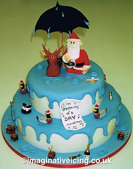 """I'm dreaming of a DRY Christmas"" Moist Christmas Cake - Santa & Rudolf knee deep in water"