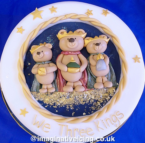 """We three kings of teddy bears far..."" modelled icing bears dressed as Kings holding gifts of gold, frankincense and myrrh - Christmas Cake"