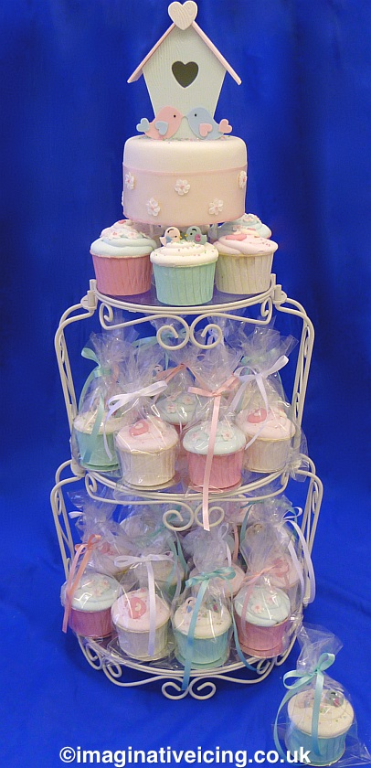 Birdhouse Wedding Cake with cakes in baking cases with bags & bows on a cake stand