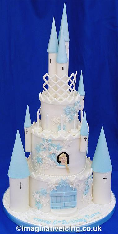 Fairytale castle cake with snowflakes & icing turrets - Princess looking out of window