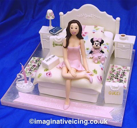 21st Birthday Girl sat on edge of cream & rose pink flowery bed - Birthday Cake