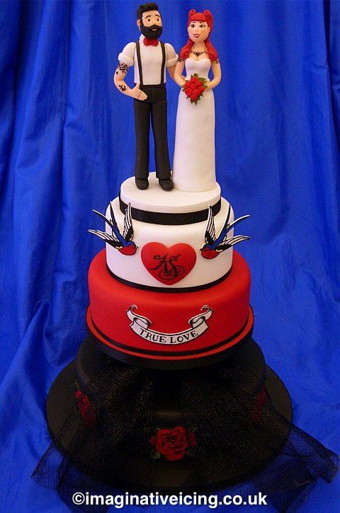 Bearded Groom & Tattooed Bride Wedding Cake with monogrammed heart, Swallows, true love swag and traditional tattoo roses